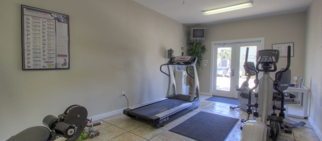 This is a photo of the Beach Retreat work out room with treadmill and weights.