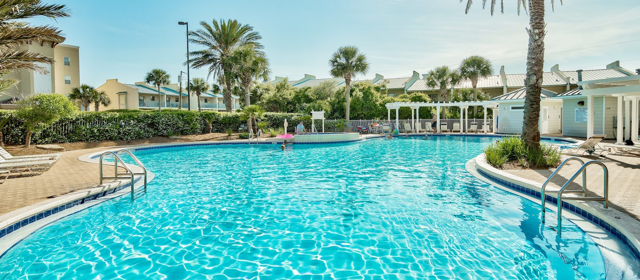 The outdoor pool has a fountain, hot tub, and tropical landscaping.