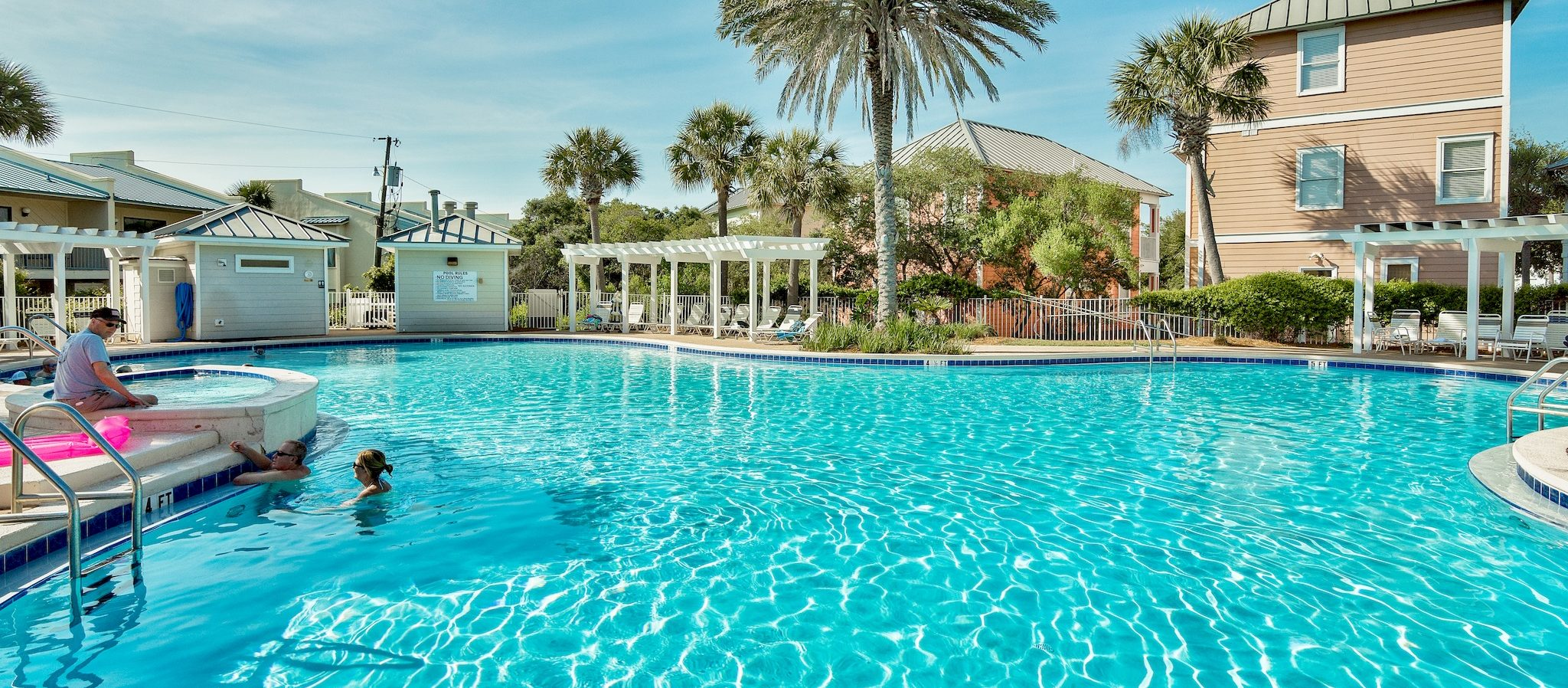 Search Destin vacation condos with lagoon style pool.