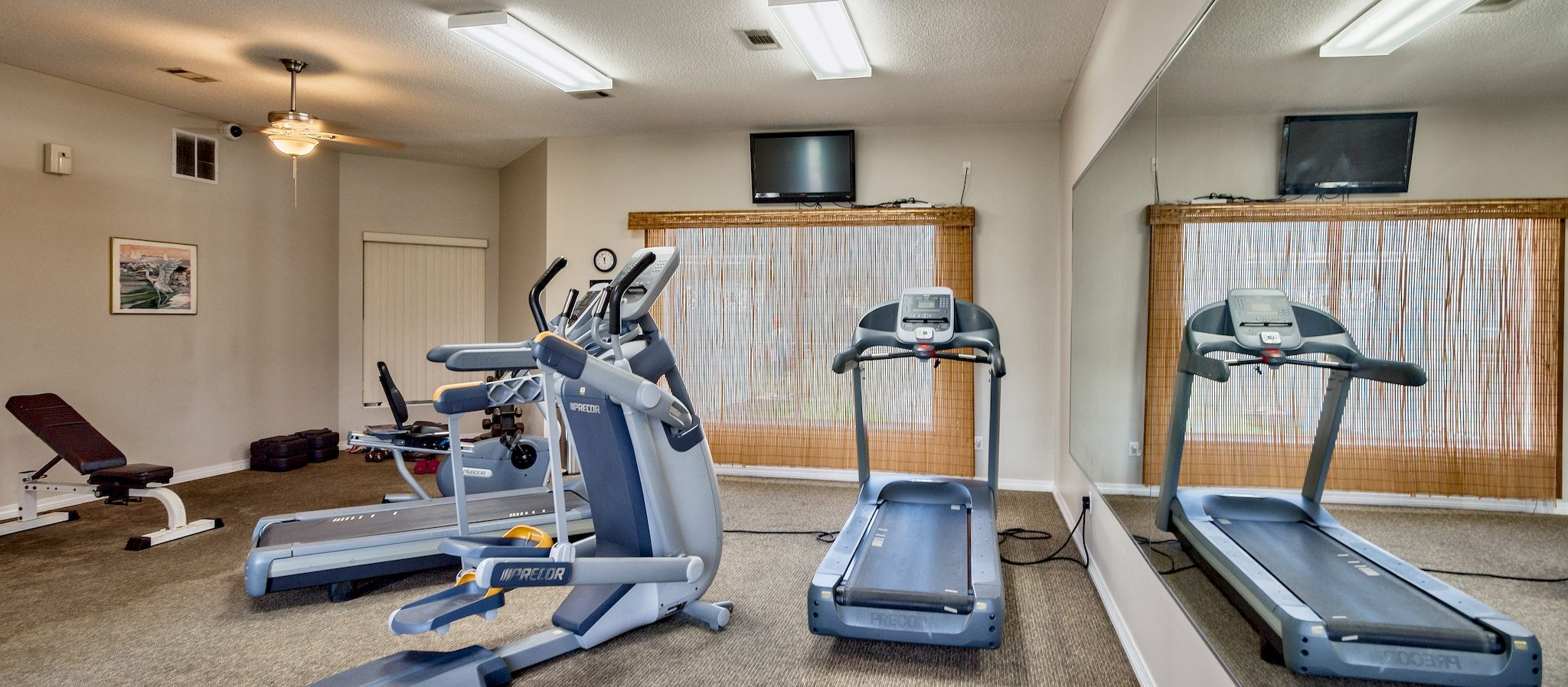 Fitness center with workout equipment.